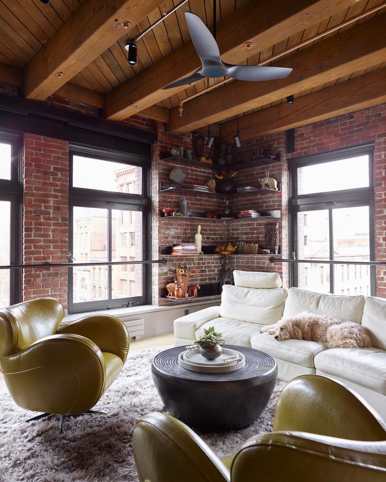 Konsep ruang tamu bergaya industrial modern cocok untuk para kaum urban yang mendambakan ruang yang simple, namun nyaman dan mudah perawatannya. Dinding bata ekspos dengan warna merah bata yang alami mampu memberikan kenyamanan dari kesederhanaannya. Jendela alumunium yang dicat hitam doff tahan lama dan mudah dibersihkan. Ekspos struktur dan pipa instalasi menjadi elemen dekorasi yang keren sekaligus mudah perawatannya.
