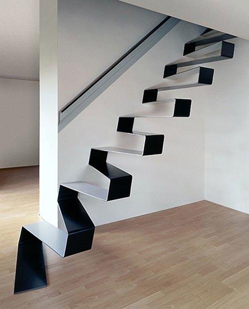 Lempengan baja bisa ditekuk dan dilipat seperti kertas origami. Pengekposan satu lempeng baja mampu menghasilkan desain floating stair yang simple but elegant. .
