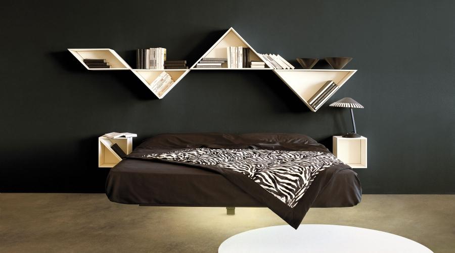 Desain tangram yang diterapkan pada rak buku minimalis (Sumber: industryinterior.com)