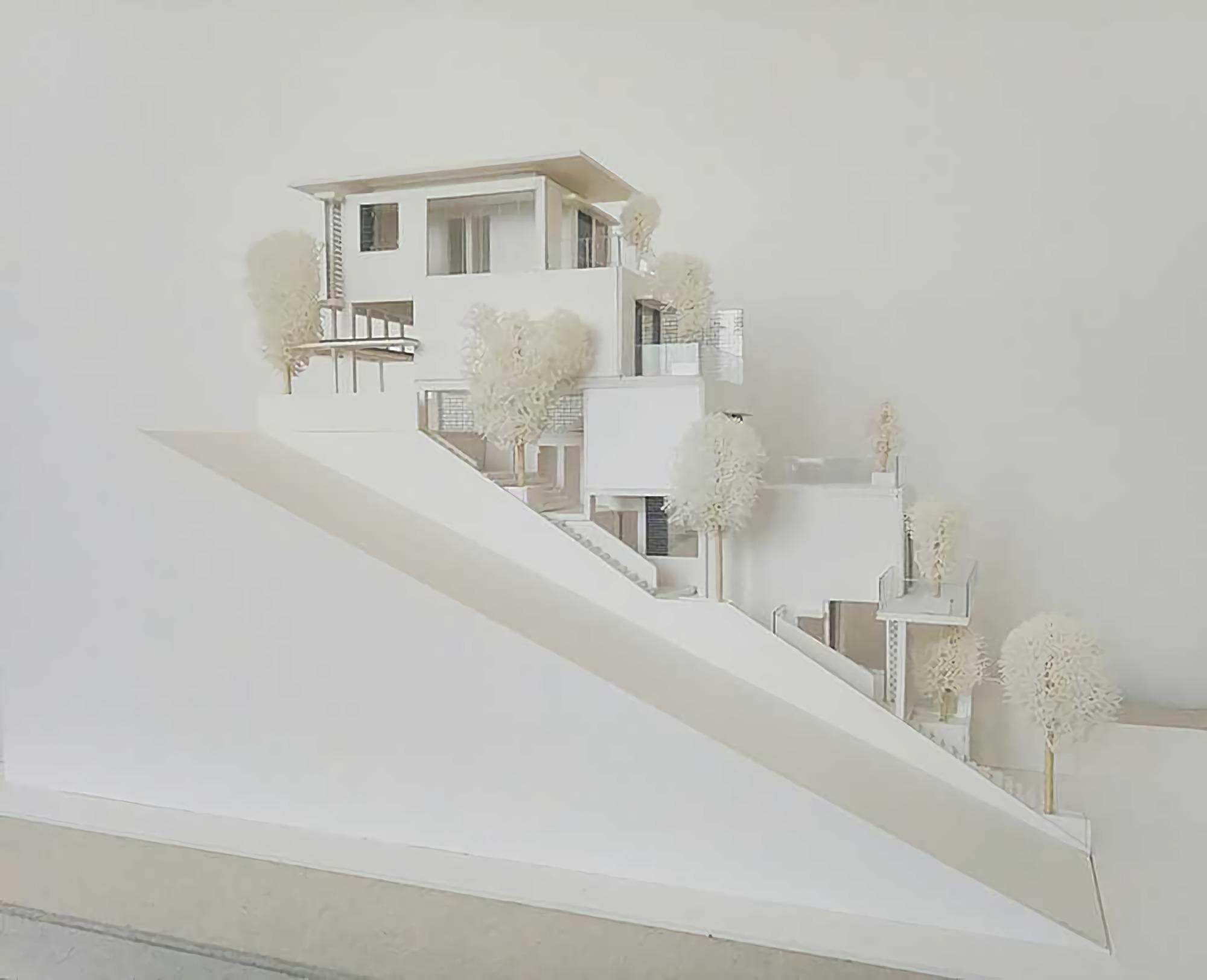 Desain rumah minimalis yang menyatu dengan tapak (Sumber: arsitag.com)