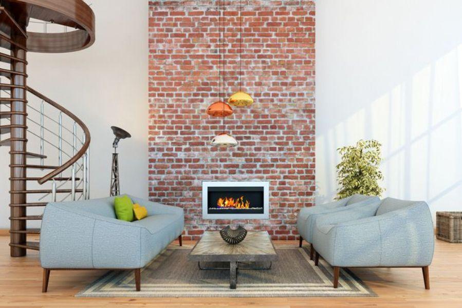 Dinding batu bata yang diekspos pada tengah ruangan menjadi focal point (Sumber: freshome.com)