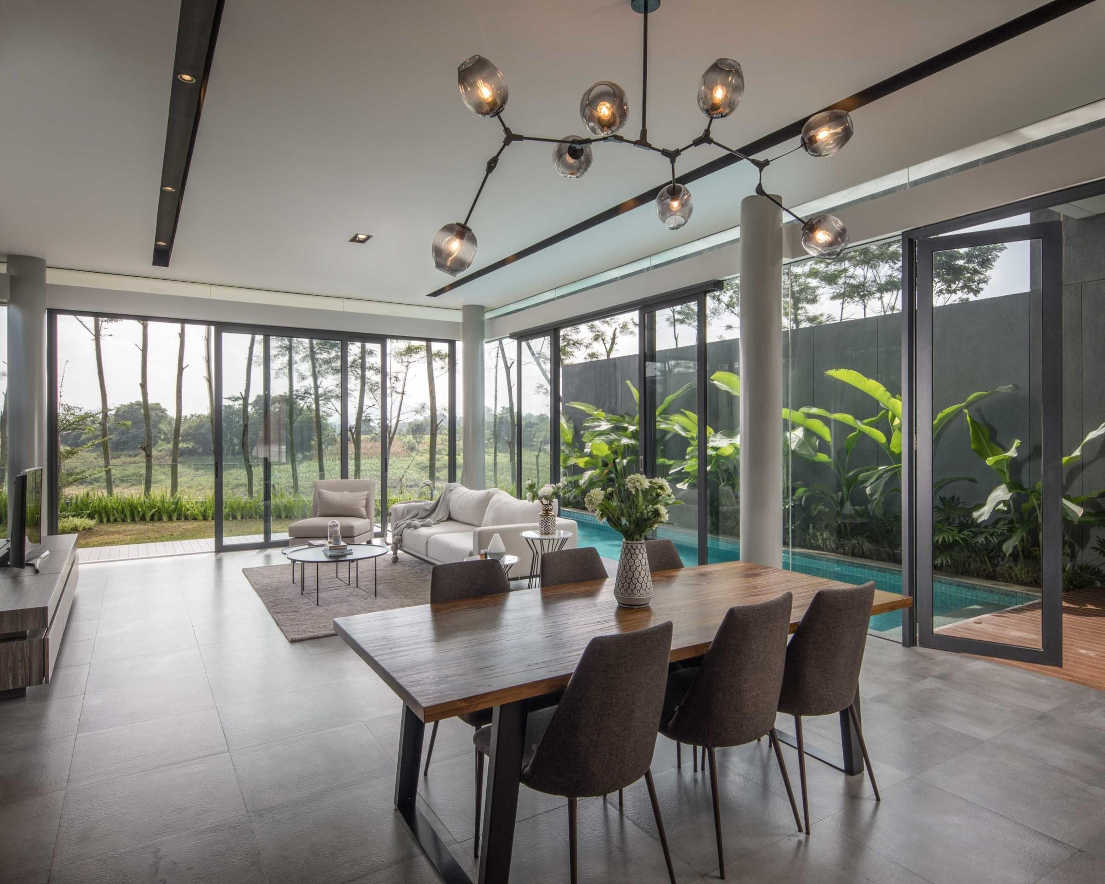 Konsep ruang terbuka yang menyatu dengan alam pada rumah modern minimalis (Sumber: arsitag.com)
