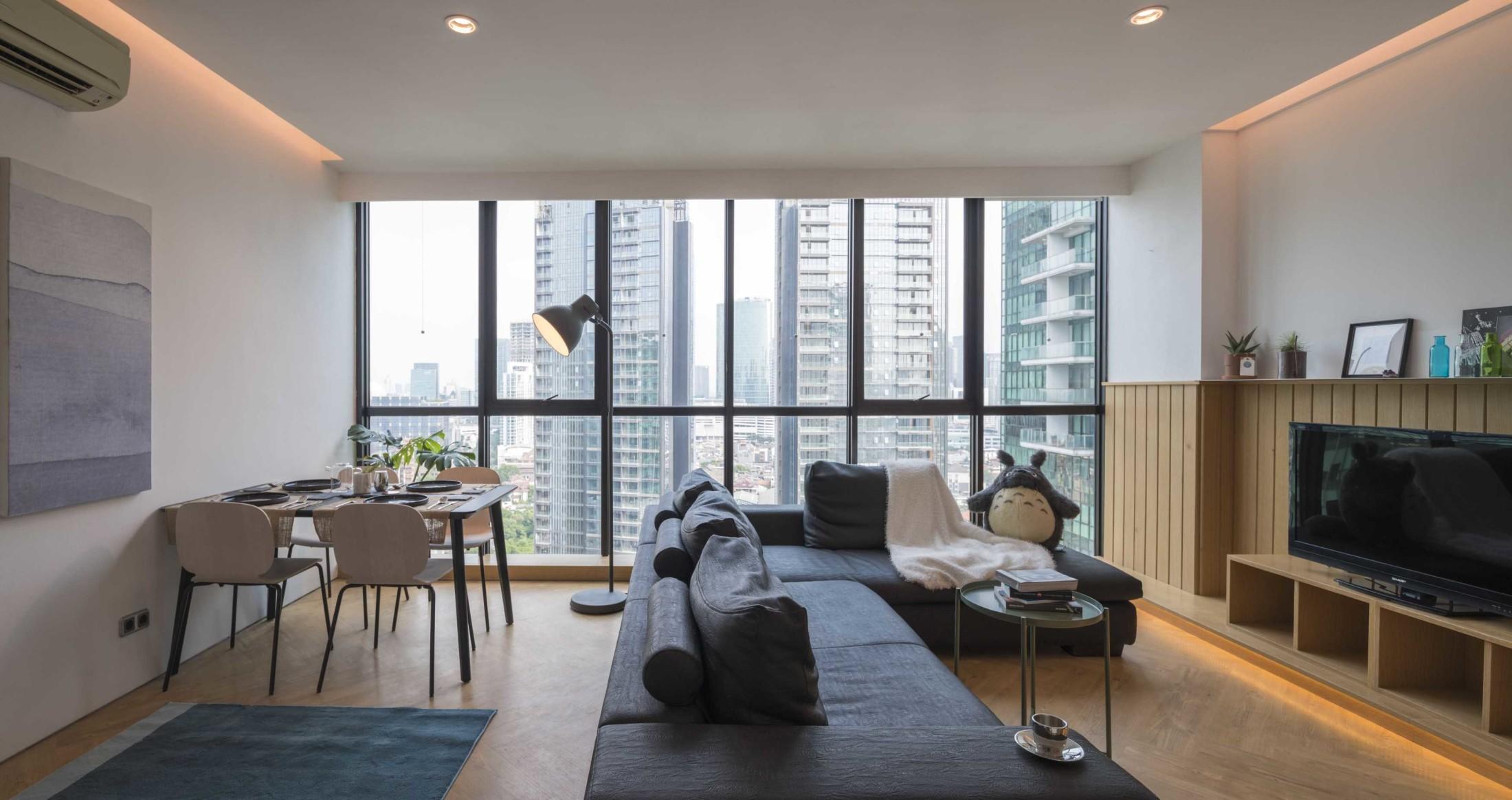 Apartemen minimalis dengan konsep ruang terbuka dan view yang luas (Sumber: arsitag.com)