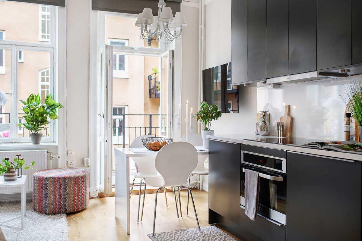 Lemari dapur dengan desain sleek di apartemen studio minimalis // home-designing.com