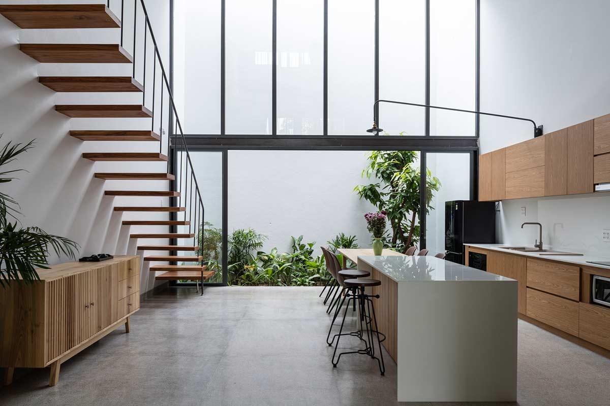 Dapur rumah tropis yang juga berkonsep minimalis karya H.a Workshop // archdaily.com