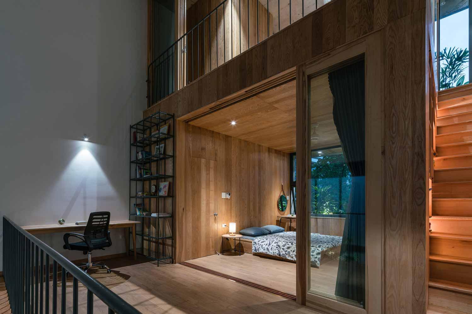 Ruang belajar dan kamar tidur rumah tropis minimalis karya H.a Workshop // archdaily.com