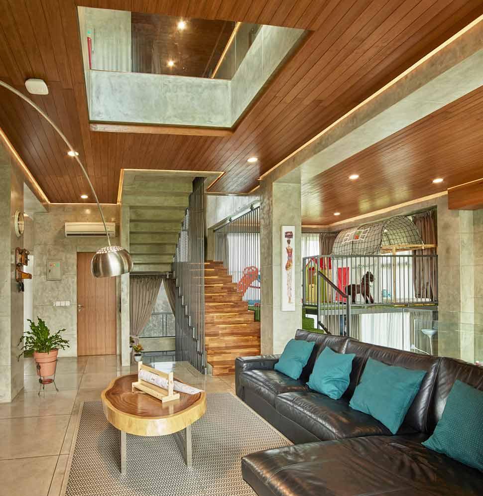 Ruang keluarga dengan ambiens yang lebih hangat // Archdaily.com