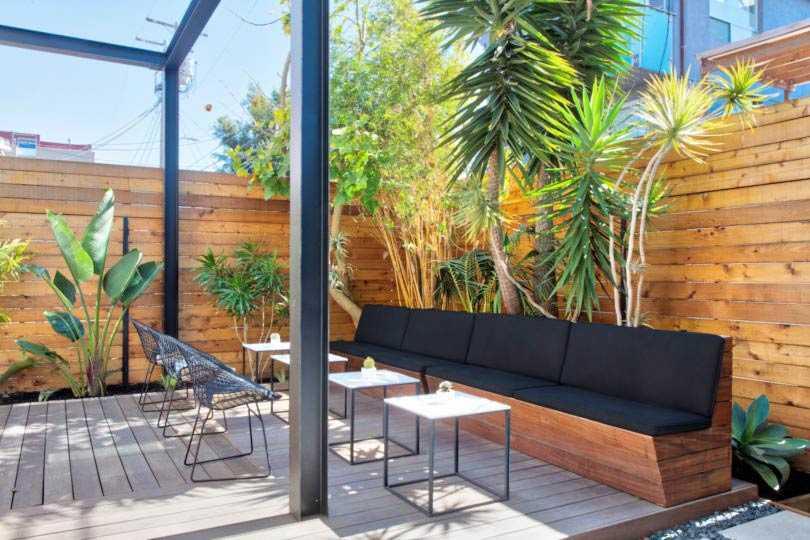 Desain tempat duduk outdoor toko minimalis karya Analog Modern, via design-milk.com